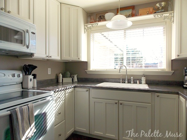 Painted Kitchen Cabinets by The Palette Muse featured on Remodelaholic