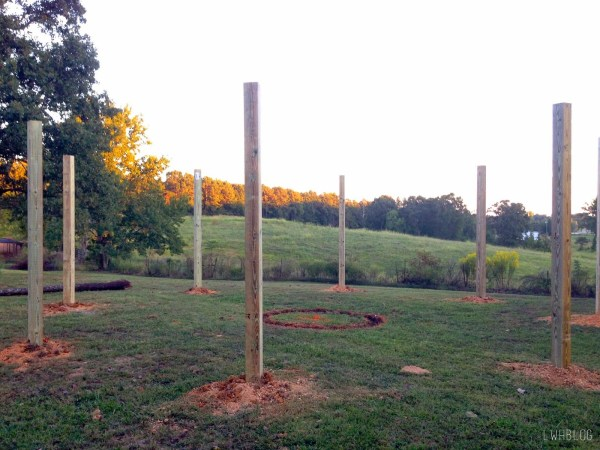 Step by Step Instructions for Building a Pergola and Fire Pit by Little White House Blog featured on @Remodelaholic