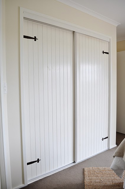 flat closet doors updated with beadboard and hinges via AKA Design