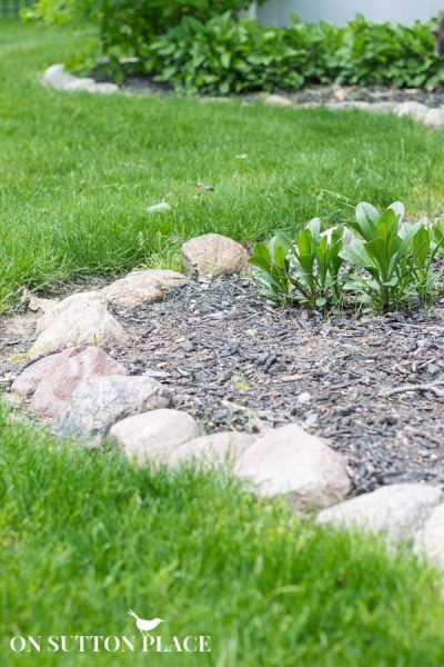 Larger rocks for a garden edge by On Sutton Place featured on Remodelaholic.com