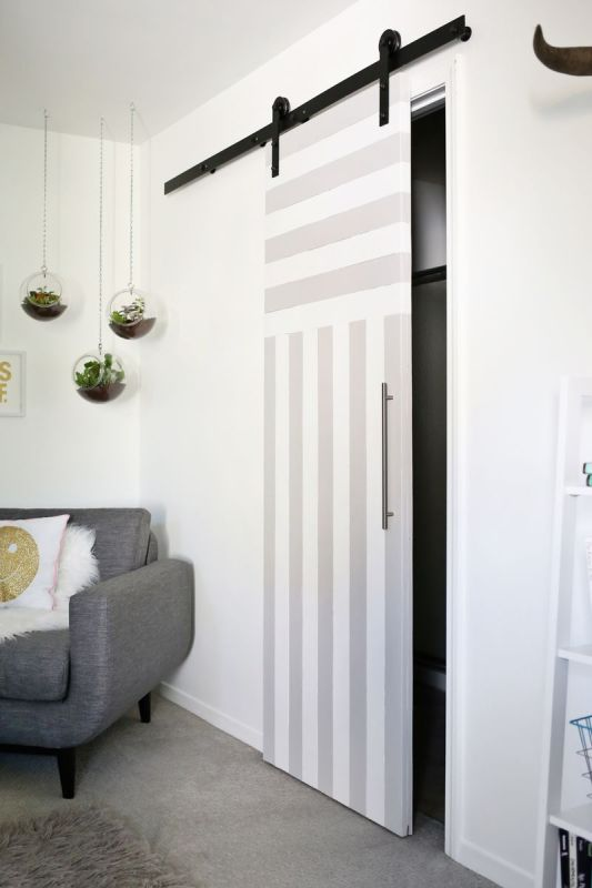 striped painted sliding door - A Beautiful Mess