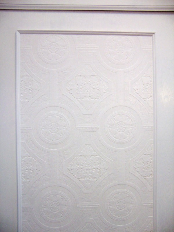 update flat closet doors with trim and textured wallpaper via @Remodelaholic