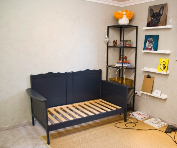 A great new sofa upcycled from an old crib by Pudel-design featured on Remodelaholic
