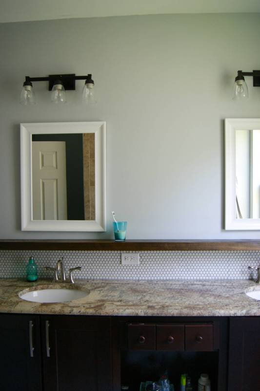 bathroom makeover with penny tile and floating wood shelf