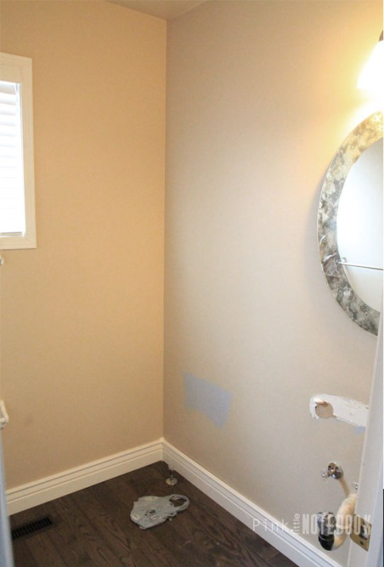 Powder Room Makeover with DIY Vanity by Pink Little Notebook featured on Remodelaholic