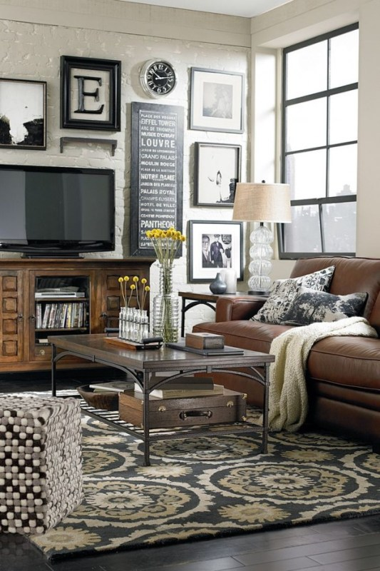 contemporary black and white gallery wall around the TV