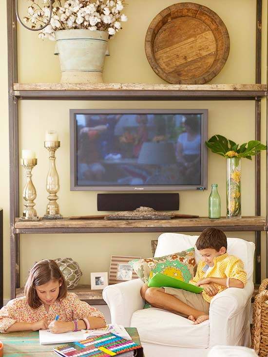 disguise a television in a large rustic shelving unit (BHG)
