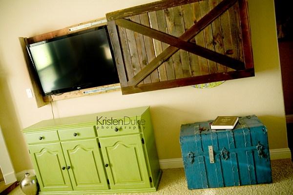 diy sliding barn door cover to hide the television (Kristen Duke Photography)