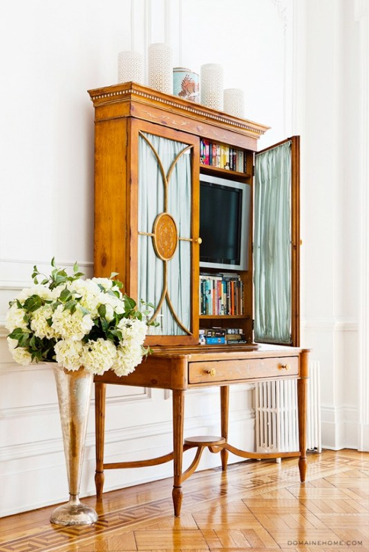 hide a television in a desk or shelving unit (My Domaine - Betsy Morgan)