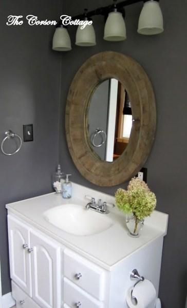 painted bathroom vanity with dark walls