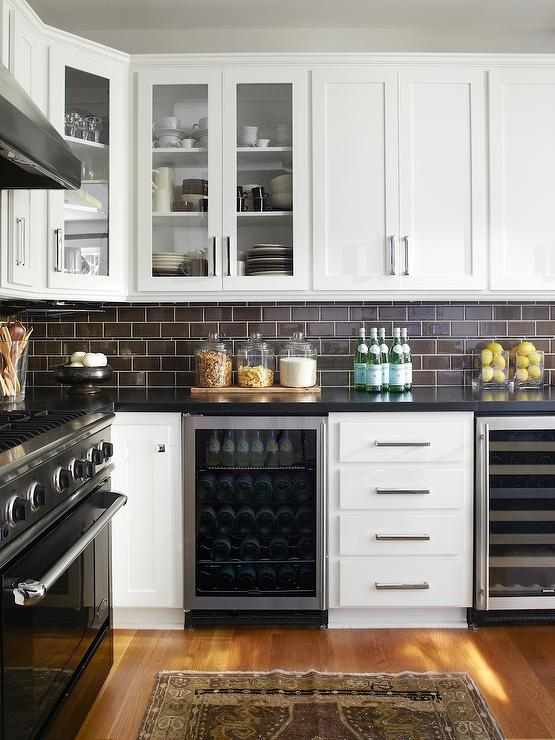 dark subway tile backsplash, BM Super White cabinets (Urrutia Design via DecorPad)