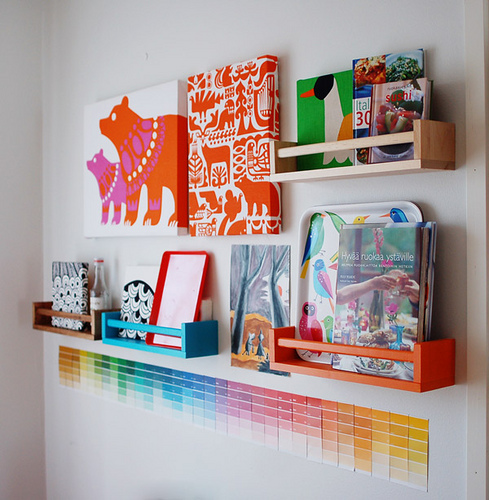 functional wall decor -- IKEA spice racks as part of a wall collection to hold books and decor
