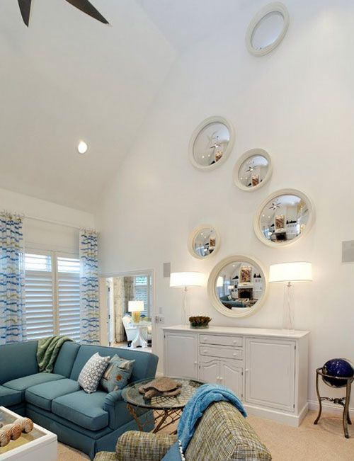 Remodelaholic   24 Ideas on How to Decorate Tall Walls oversized mirror