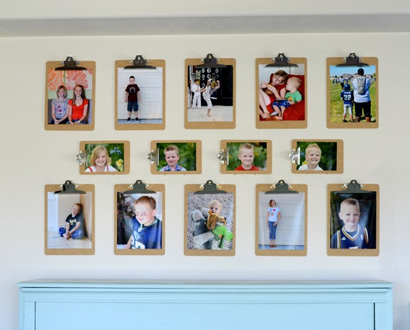 photo display using large and small clipboards (via Kristen Duke Photography)