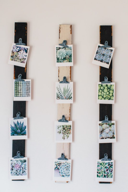 simple boards and metal clips photos display (via Design Sponge)