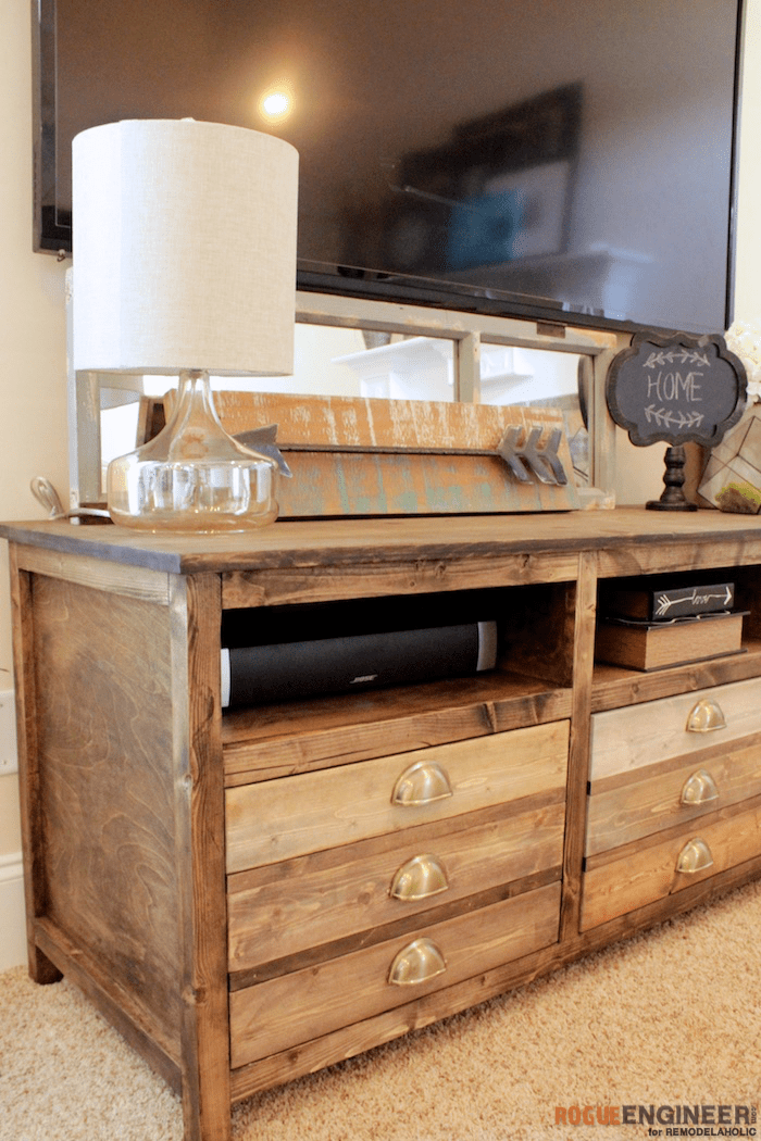 DIY Printmakers Media Console Plans | This roomy DIY console features 3 open shelves and 3 extra-large easy drawers for storage -- with no drawer slides required!