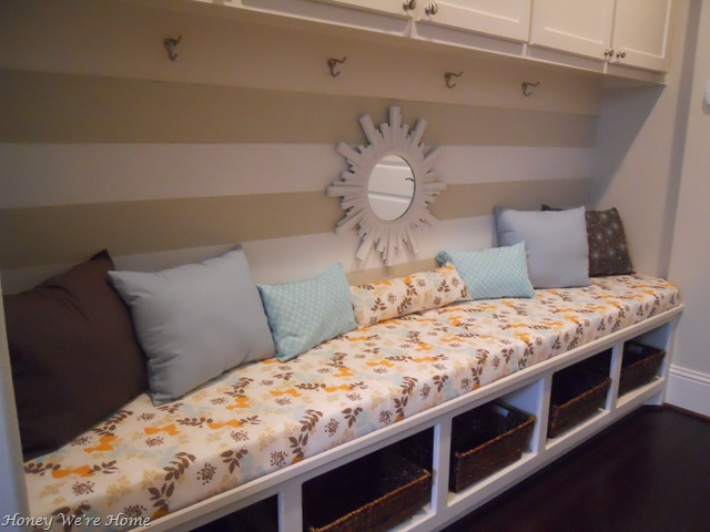 Add a cubby bench for seating and storage in the hallway