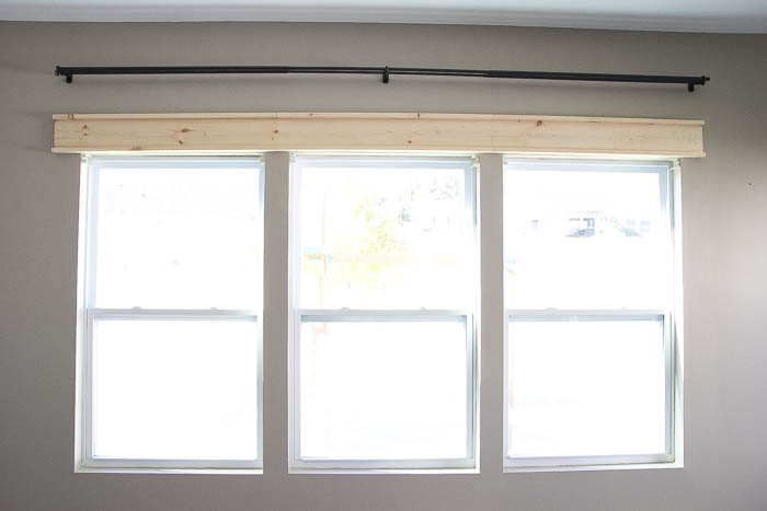 How to install a header on the DIY Craftsman Trim featured on Remodelaholic.com