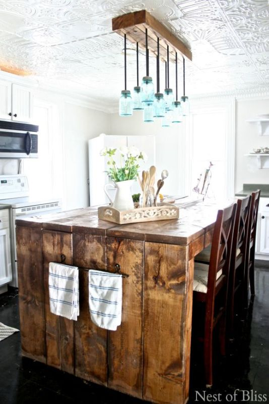 Farmhouse Kitchen Inspiration - this chunky wood island is AMAZING! And the ceiling!
