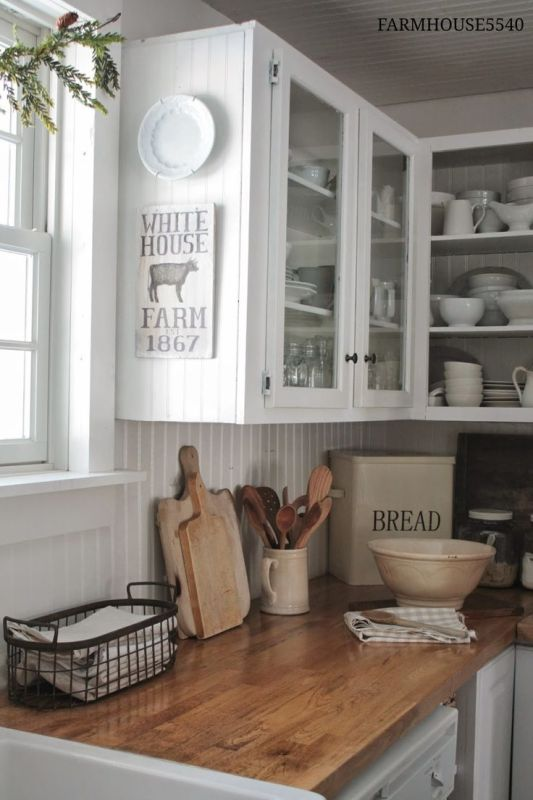 Farmhouse Kitchen Inspiration -- wood counterops, white cabinets with glass doors for display