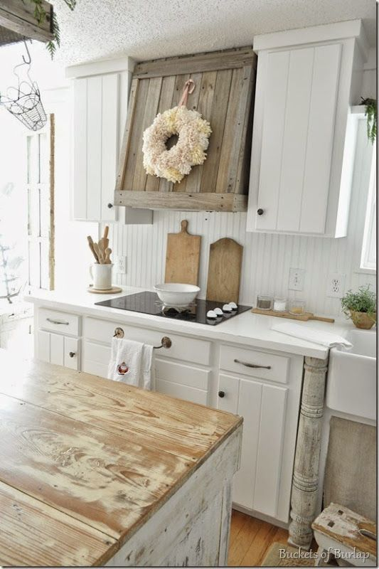 Farmhouse Kitchen Inspiration -- love the reclaimed wood range hood and the newel post by the sink