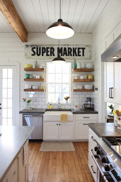 Farmhouse Kitchen Inspiration -- wood floating shelves on either side of the sink, perfect! And are those concrete countertops, too?