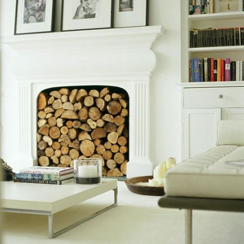 Decorating a non-working fireplace: filled with logs
