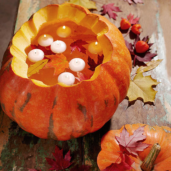 carved pumpkins with floating candles