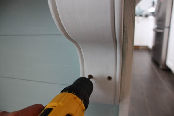 installing decorative corbels on a kitchen island tutorial, The Happy Housie on @Remodelaholic