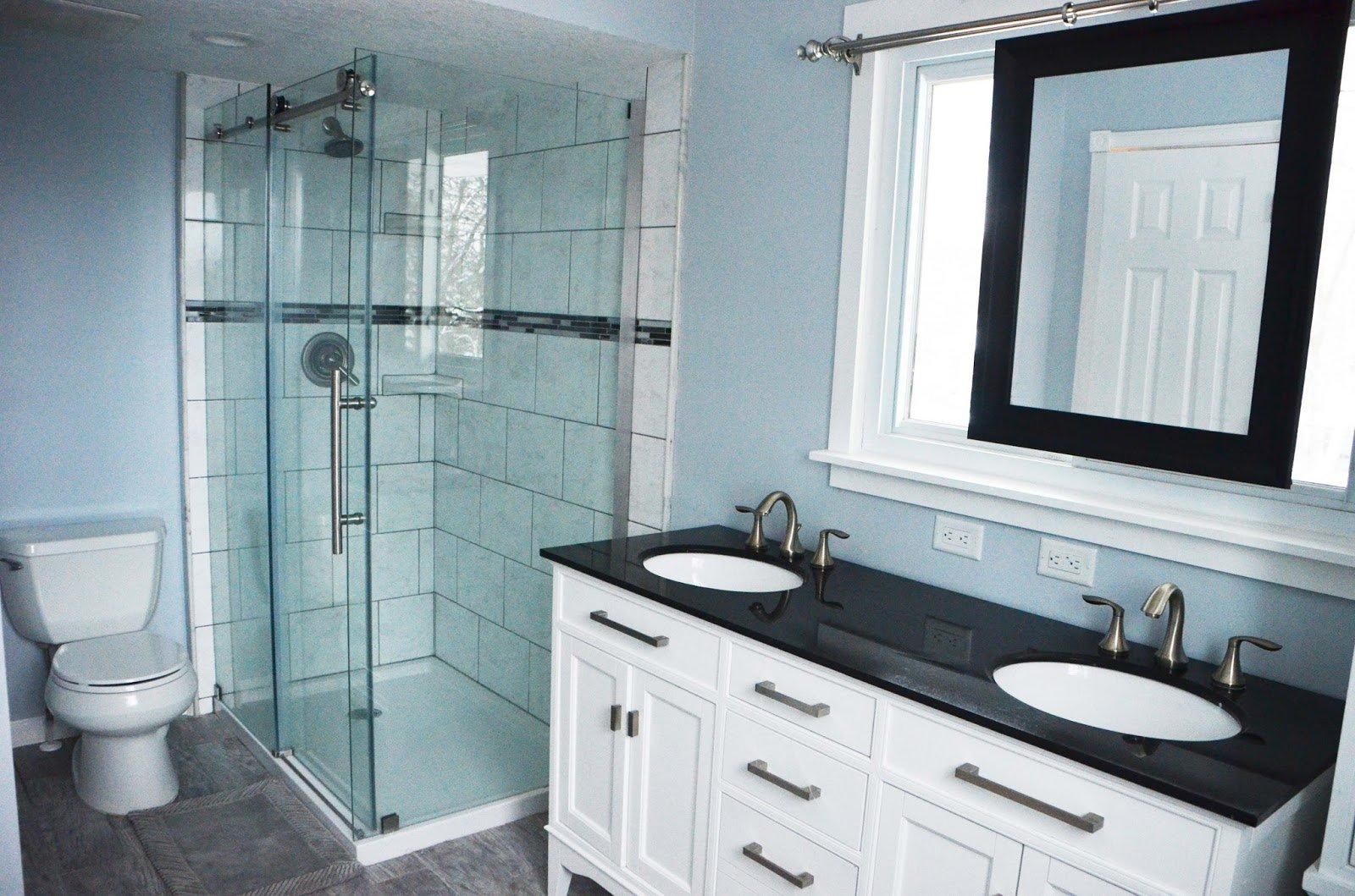 Bathroom Renovation With Sliding Mirror Over Window, Dark Vanity Countertop  Over White Vanity, By
