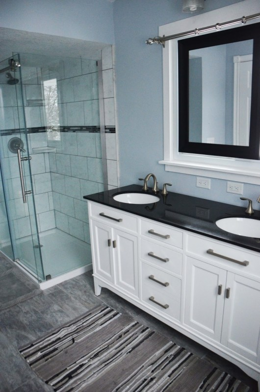 Master Bathroom Renovation, gray and white bathroom with dark accents, by Since I Became a Mom featured on @Remodelohic