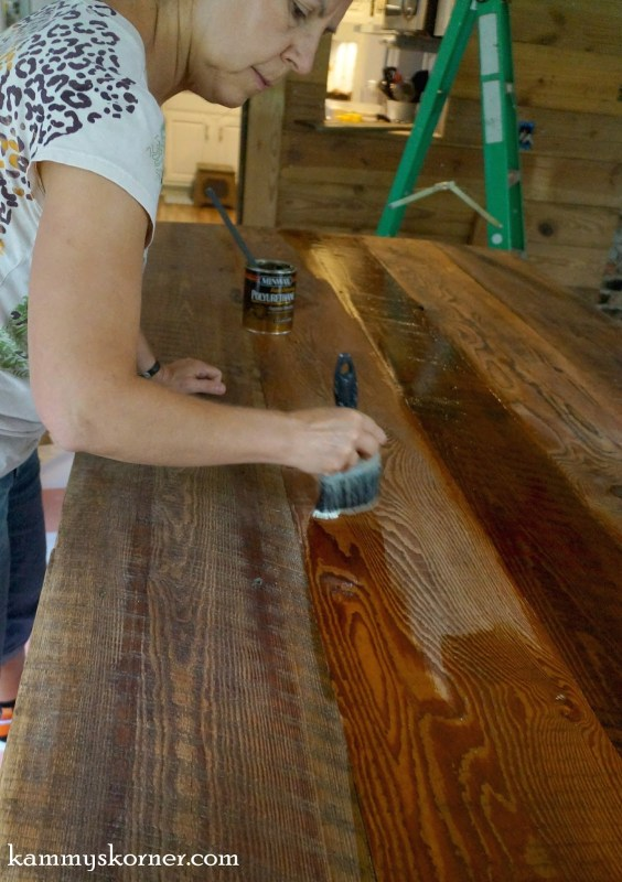 11 Polyurethane to finish reclaimed barn wood table top, by Kammie's Korner featured on @Remodelaholic