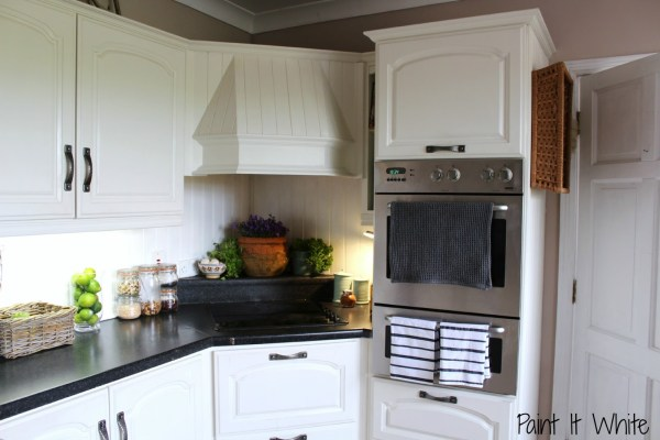 Annie Sloan chalk paint in Old White wood kitchen cabinet update, Rustic accents for white kitchen, by Paint it White featured on @Remodelaholic