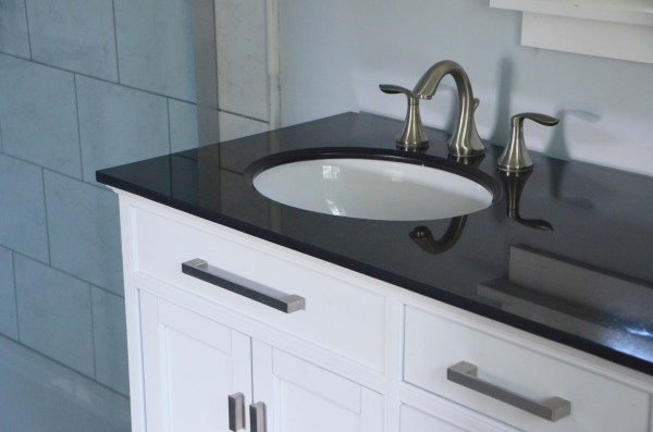 Dark countertop over white vanity, Master Bath Renovation, by Since I Became a Mom featured on @Remodelohic