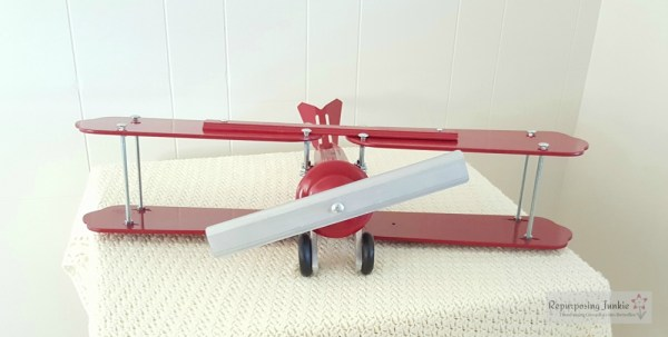 15 Build decorative airplane from repurposed ceiling fan blades, front view 1, by Repurposing Junkie featured on @Remodelaholic