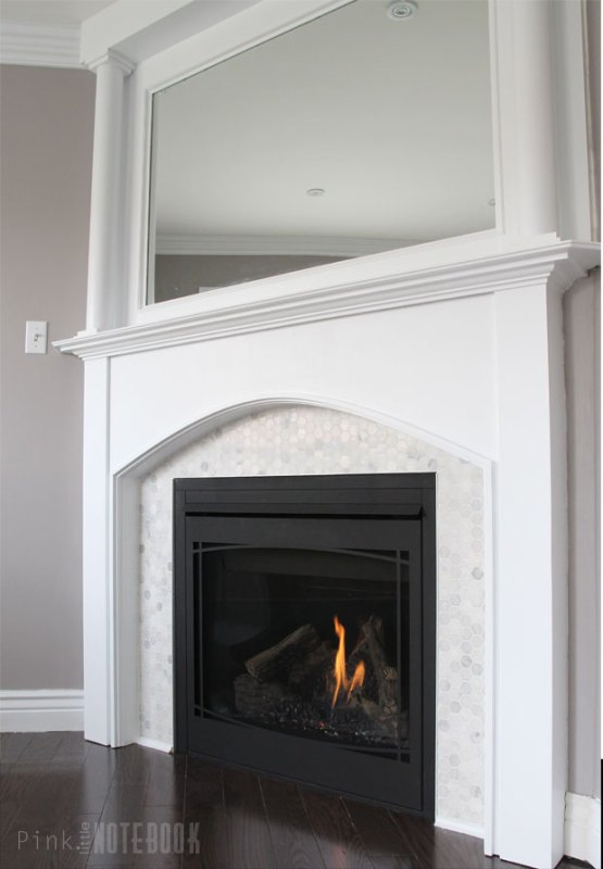 How to update a dated tile fireplace and mirrored mantel -- such a great DIY job for a fresh look! Pink Little Notebook on Remodelaholic.com