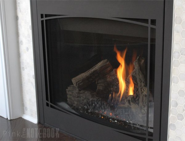 Marble hex tile in DIY fireplace surround makeover Pink Little Notebook featured on @Remodelaholic