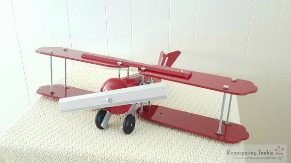 20 Build decorative airplane from repurposed ceiling fan blades, front view 6, by Repurposing Junkie featured on @Remodelaholic