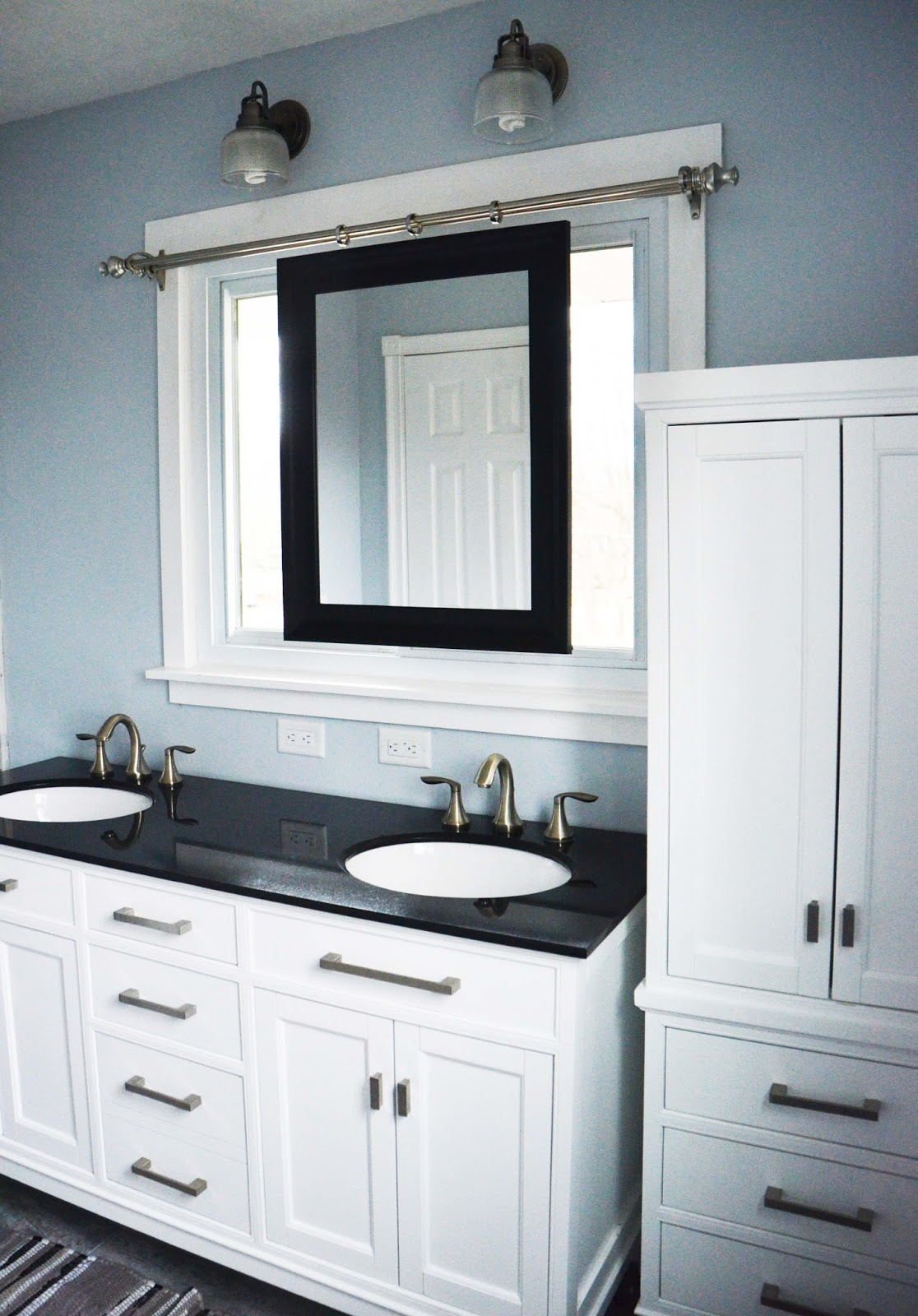Beautiful Master Bathroom Renovation, White With Dark Countertops, And A  Smart Sliding Mirror Over