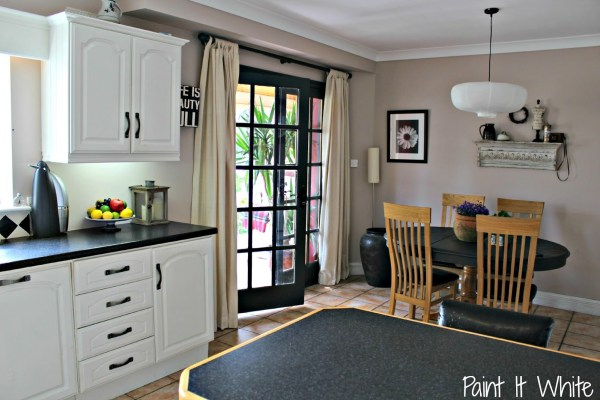 6 Annie Sloan Chalk Paint in Old White for kitchen cabinet makeover, Provence with Dark Wax for kitchen island, Paint it White featured on @Remodelaholic