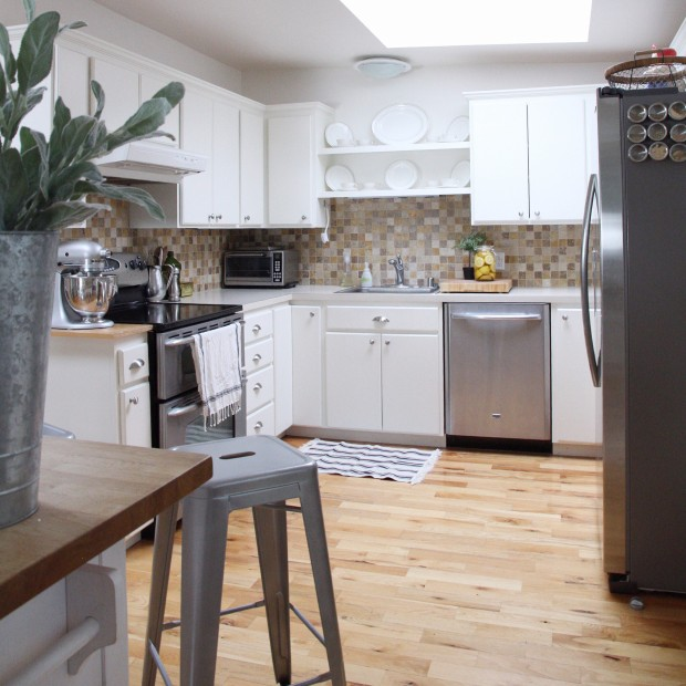 Remodelaholic kitchen mini makeover with affordable tiled diy before diy marble countertop tutorial self installed over existing laminate counter zevy solutioingenieria Gallery