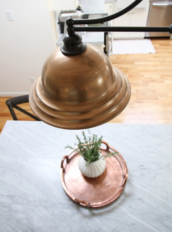 This faux copper painted light is so gorgeous in this white and marble kitchen!