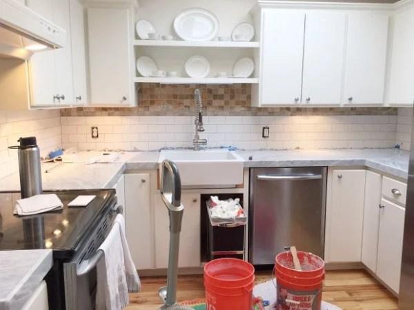 how to apply porcelain subway backsplash tiles over existing tile backsplash, Zevy Joy featured on @Remodelaholic