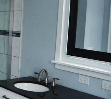 Master Bathroom Renovation with Sliding Mirror Over the Window