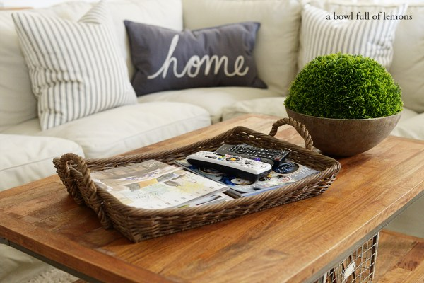 use a coffee table tray to corral remotes and magazines