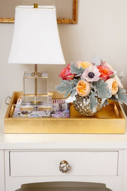 use a large tray to contain nightstand items via StyleCaster