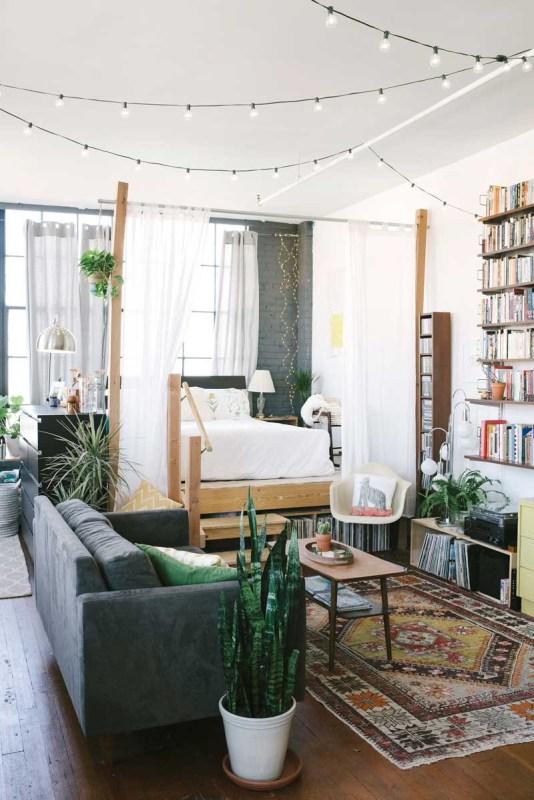 use a string of bistro lights in a living room via Design Sponge