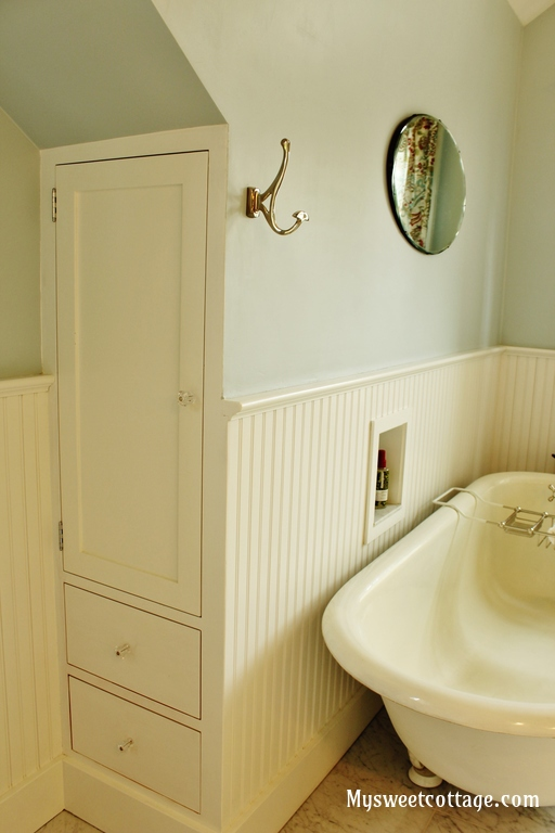 16 Custom built-in linen closet to maximize space in a dormer window bathroom, My Sweet Cottage featured on @Remodelaholic