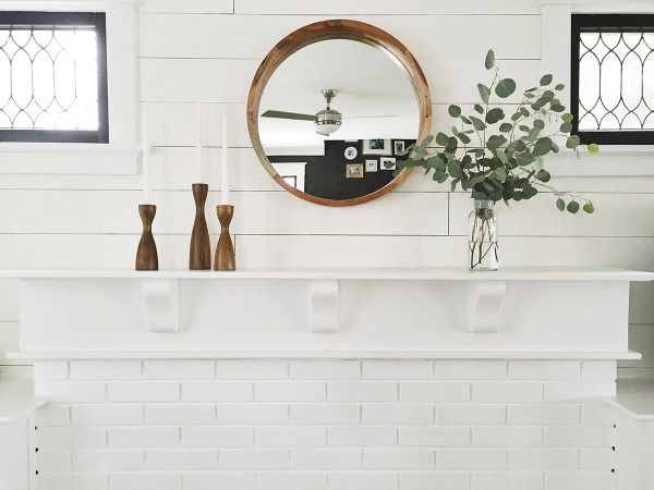 Stunning white fireplace and mantel with black window frames -- every home needs black window frames, right?
