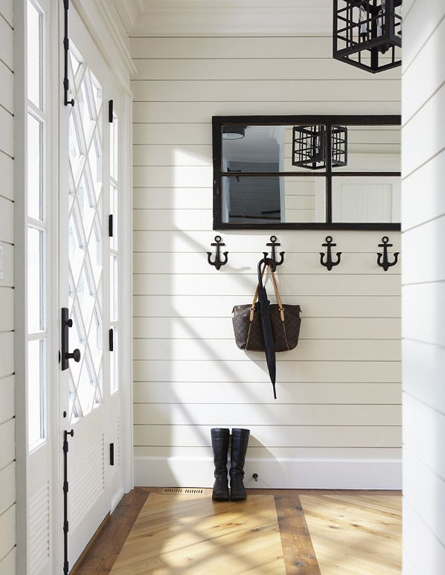 Can I just move in? this mudroom/entry is perfect. The wood floors, the anchor wall hooks, and that FRONT DOOR!! I want it all.